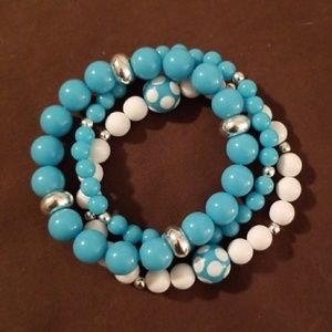 3 teal colored bracelets